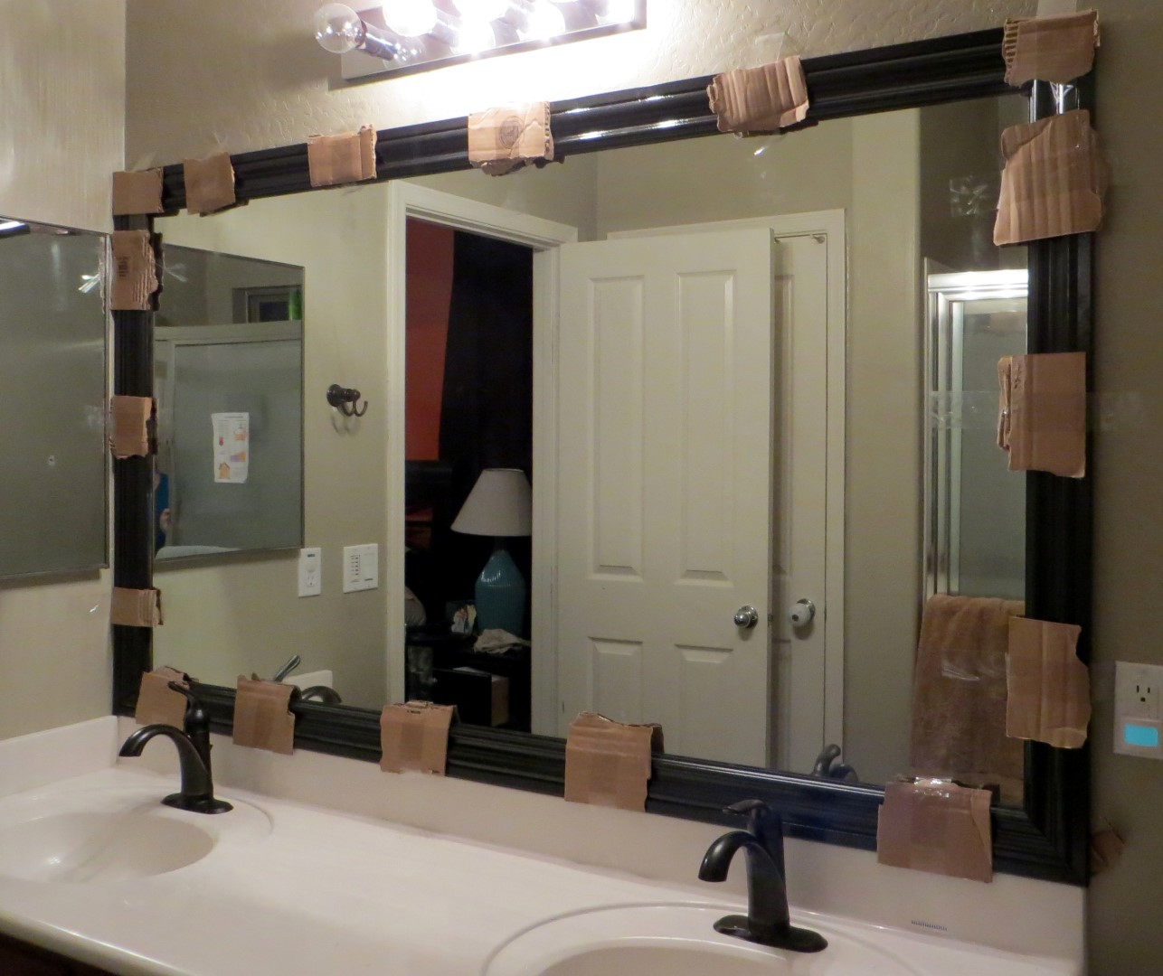 How to frame a mirror the builder 39 s installed a mom 39 s take Frames for bathroom wall mirrors