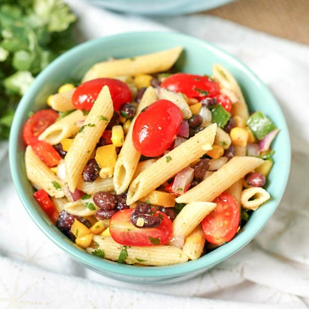 All the flavor of texas and mexico in one exciting, flavorful pasta salad! This Tex-Mex salad is a crowd pleaser. Homemade dressing and loaded with veggies.