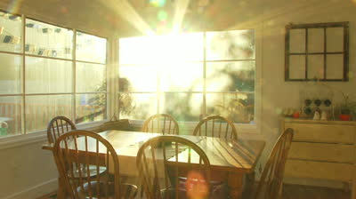 stock-footage-bright-sunset-shines-through-window-of-dining-room-at-house-time-lapse