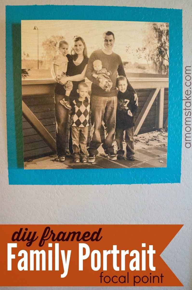 DIY Framed family pictures focal point