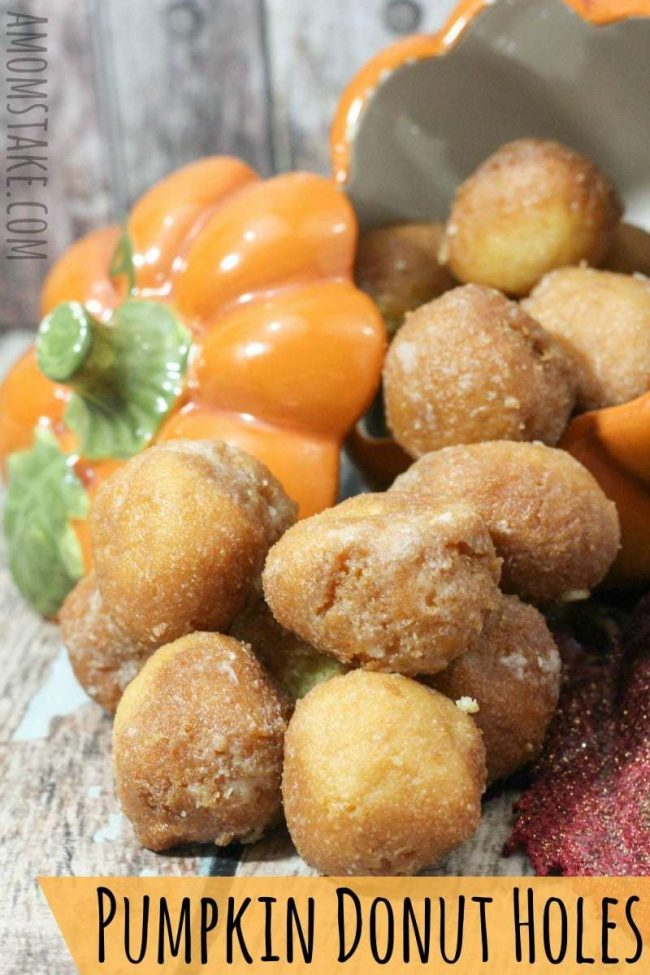 Traditional donut holes are oh-so-yummy, but this fall inspired recipe is even better! This baked pumpkin donut recipe combines pumpkin pie seasoning blends, pumpkin puree, and a sweet sugar glaze.