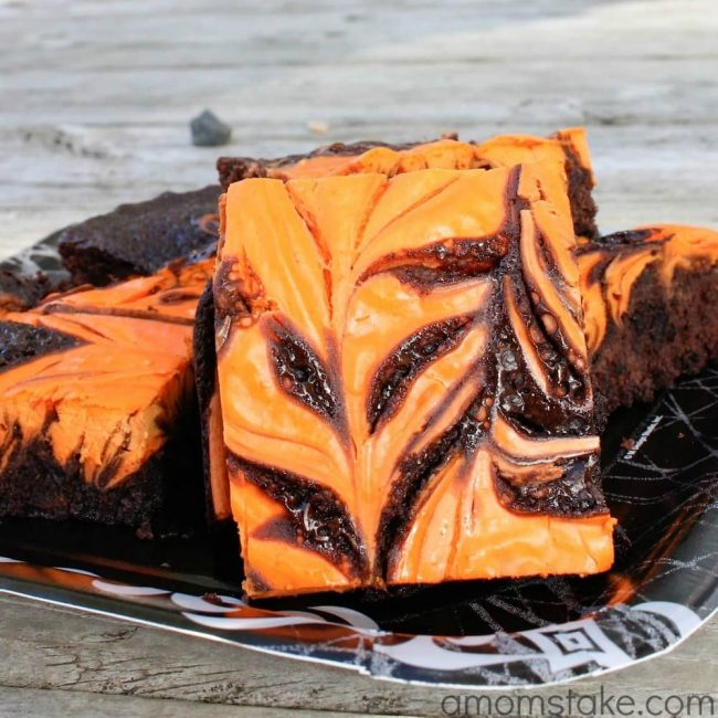 Easy Halloween Brownies recipe with a yummy cream cheese swirled throughout - plus swaps that make these brownies amazing!