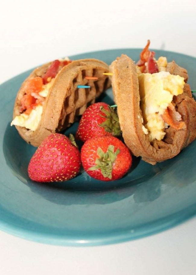 This is my go-to easy breakfast recipe! Just your favorite breakfast foods like eggs, sausage, bacon, cheese - whatever you love - crammed inside a tasty waffle! It's so fast and yet filling and healthy! Seriously, you've got to try to make these Breakfast Waffle Tacos!