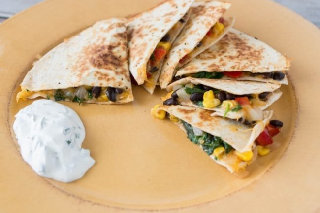 This southwest recipe is FULLY loaded! It is amazing, you'll never eat your quesadilla any other way. Topped with all your favorites, a filling lunch or dinner.