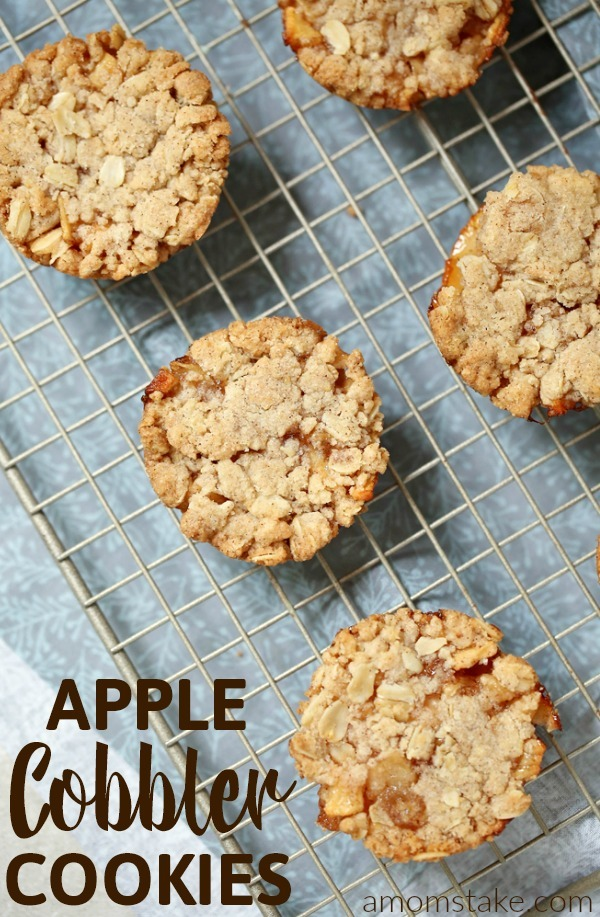 A fun and fruity cookie, this twist on traditional apple cobbler brings a warm and tasty cookie recipe you'll love! These apple cobbler cookies have a warm crumbly topping and sweet fruity inside.