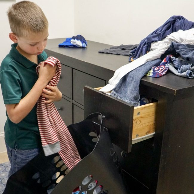 kid sorting laundry