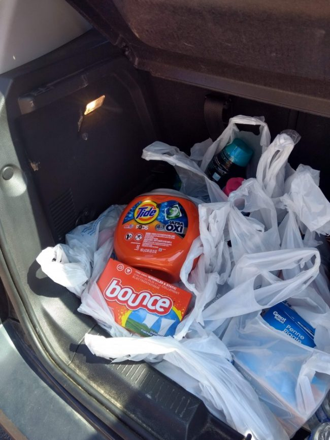 laundry products in the truck of a car